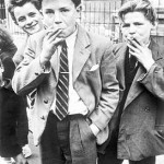 Young scallywags having a smoke behind the bike shed (tsk)