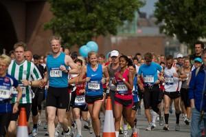 Smiling runners in Copenhagen marathon